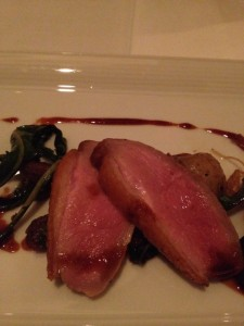 Roasted Moulard Duck Breast  with sautéed dandelion greens,bing cherries and muscat jus paired