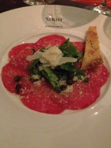 , Carpaccio Di Manzo . Beef carpaccio ,lemon oil dressing ,fried capers and a shaving of parmesan cheese