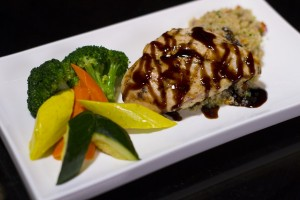 Chicken Breast topped with Monari Federzoni balsamic glaze and served with a side of steamed vegetables and quinoa pilaf (580 calories).