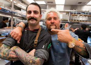 Guy Fieri poses with his executive chef, Tony Leitera,   Photo credit:     Erik Kabik.